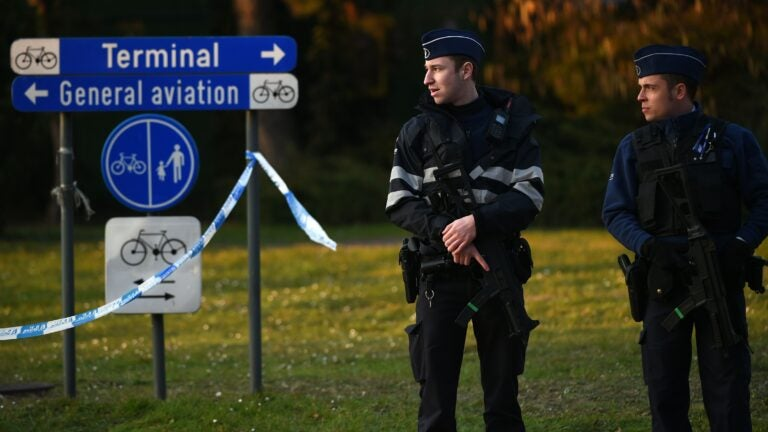 Police officers stand guard at the Brussels Airport in Zaventem following twin blasts on March 22, 2016. Around 35 people were killed and more than 200 wounded in a series of attacks in Brussels today claimed by the Islamic State group and described as a strike at the very heart of Europe. / AFP PHOTO / PATRIK STOLLARZPATRIK STOLLARZ/AFP/Getty Images