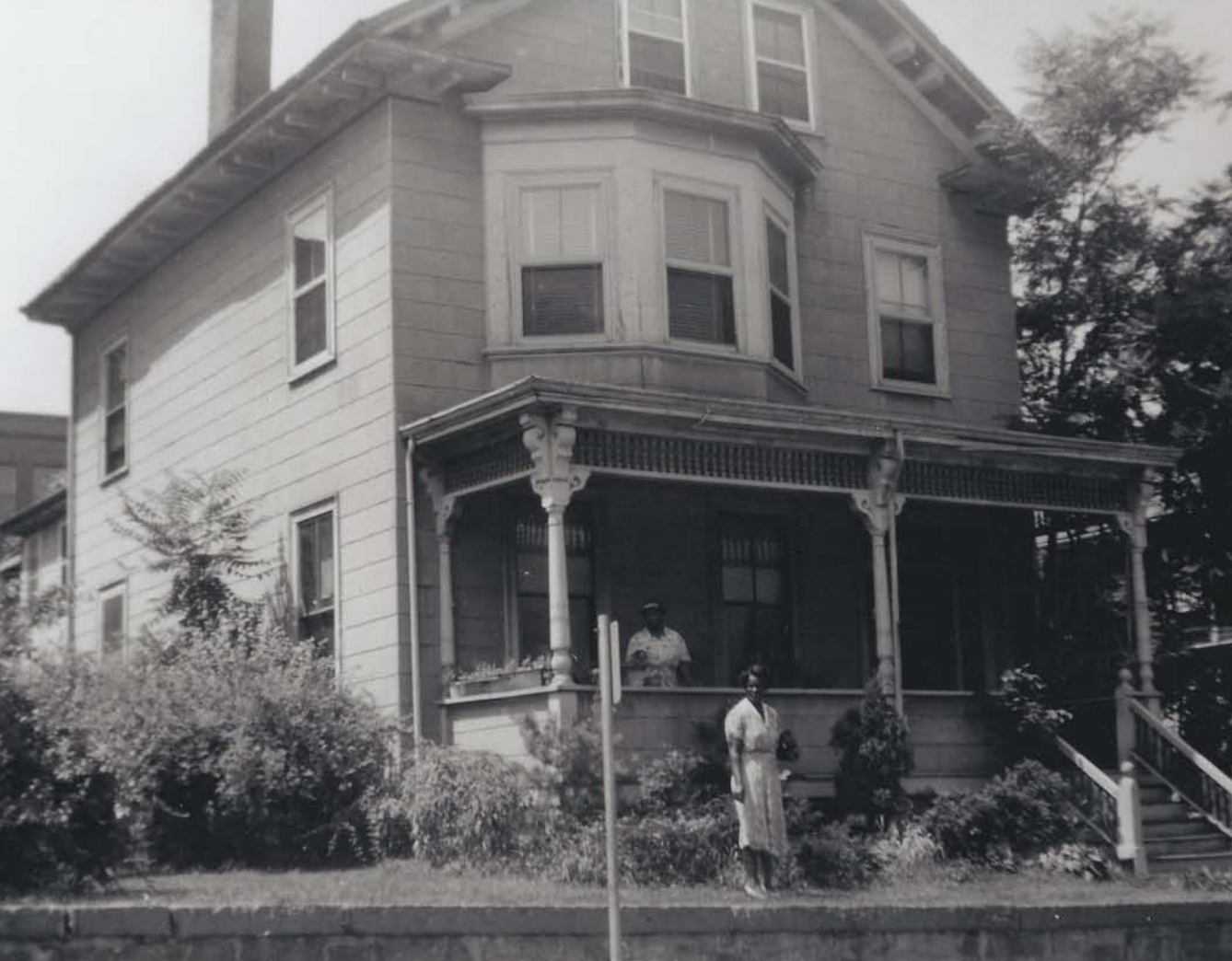Ella Little-Collins and Sara Little in front of the Roxbury home where Malcolm X lived.