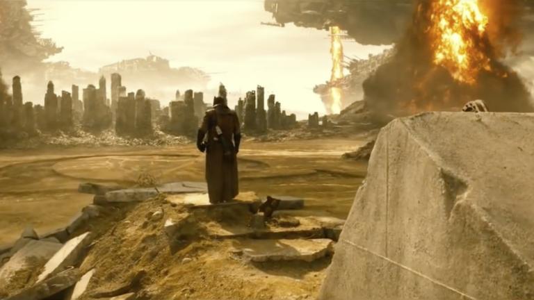 Batman surveys the desert in a scene from Batman v Superman.
