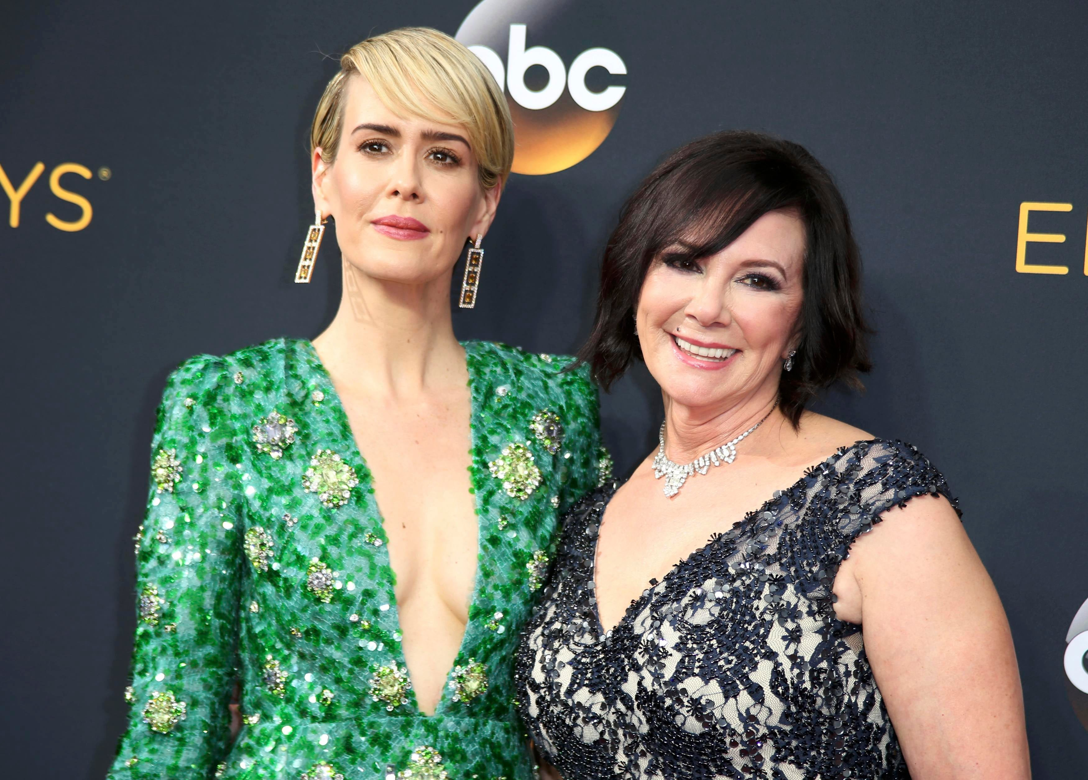 """Actress Sarah Paulson from FX Network's """"The People v. O. J. Simpson: American Crime Story"""" and prosecutor Marcia Clark arrive at the 68th Primetime Emmy Awards in Los Angeles, California U.S., September 18, 2016. REUTERS/Lucy Nicholson"""