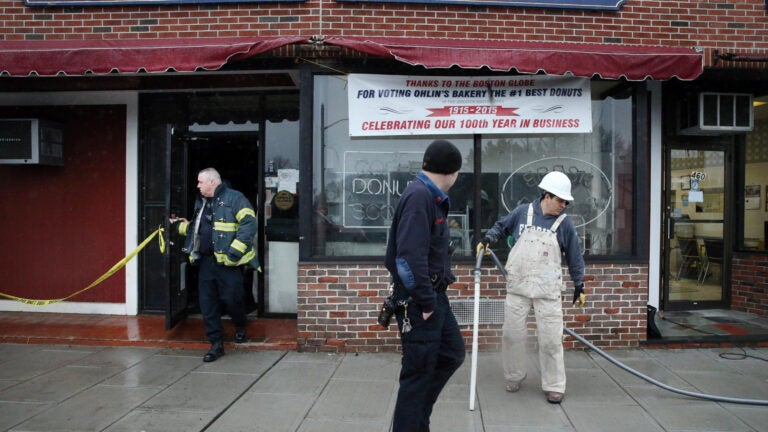 31webelmont - A construction worker clears the scene of the oven explosion at Ohlin's Bakery in Belmont. (Craig F. Walker/Globe Staff)