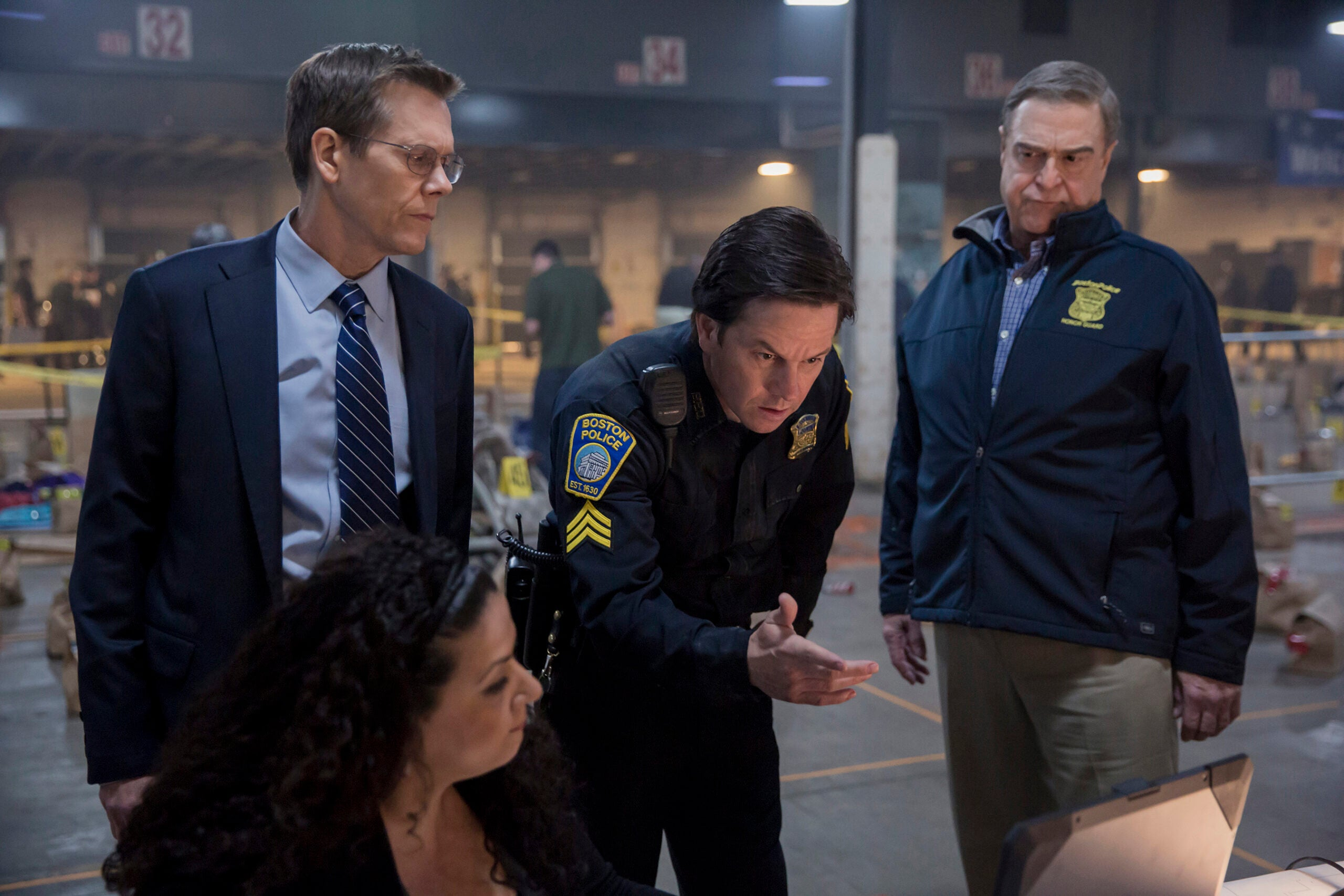 (Standing, left to right) Kevin Bacon, Mark Wahlberg and John Goodman in the 2016 film PATRIOTS DAY, directed by Peter Berg.