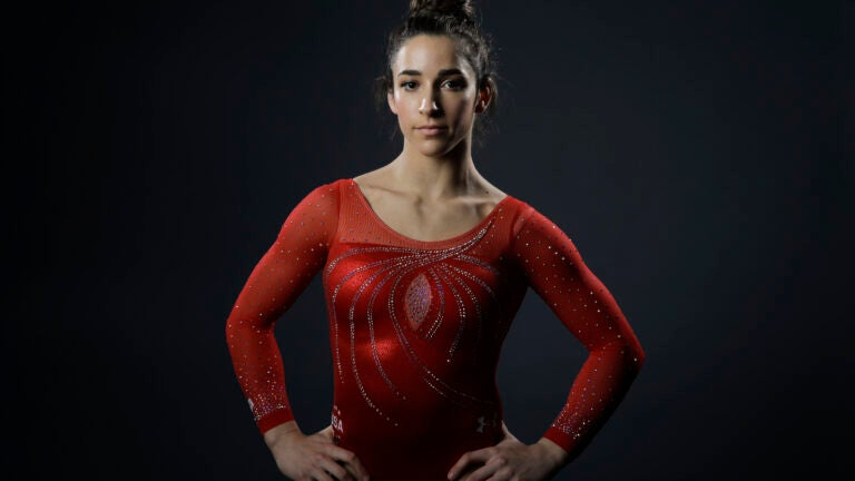 FILE - In this March 7, 2016, file photo, gymnast Aly Raisman poses for photos at the 2016 Team USA Media Summit in Beverly Hills, Calif. Six-time Olympic medalist Aly Raisman's gymnastics career has set the stage for what she believes is the next chapter in her life: as a spokesperson for victims of sexual abuse. The 23-year-old detailed her own history of abuse by a former USA Gymnastics team doctor in her recently released autobiography. Raisman says the book is just the beginning in her quest to bring change to her sport.(AP Photo/Jae C. Hong, File)