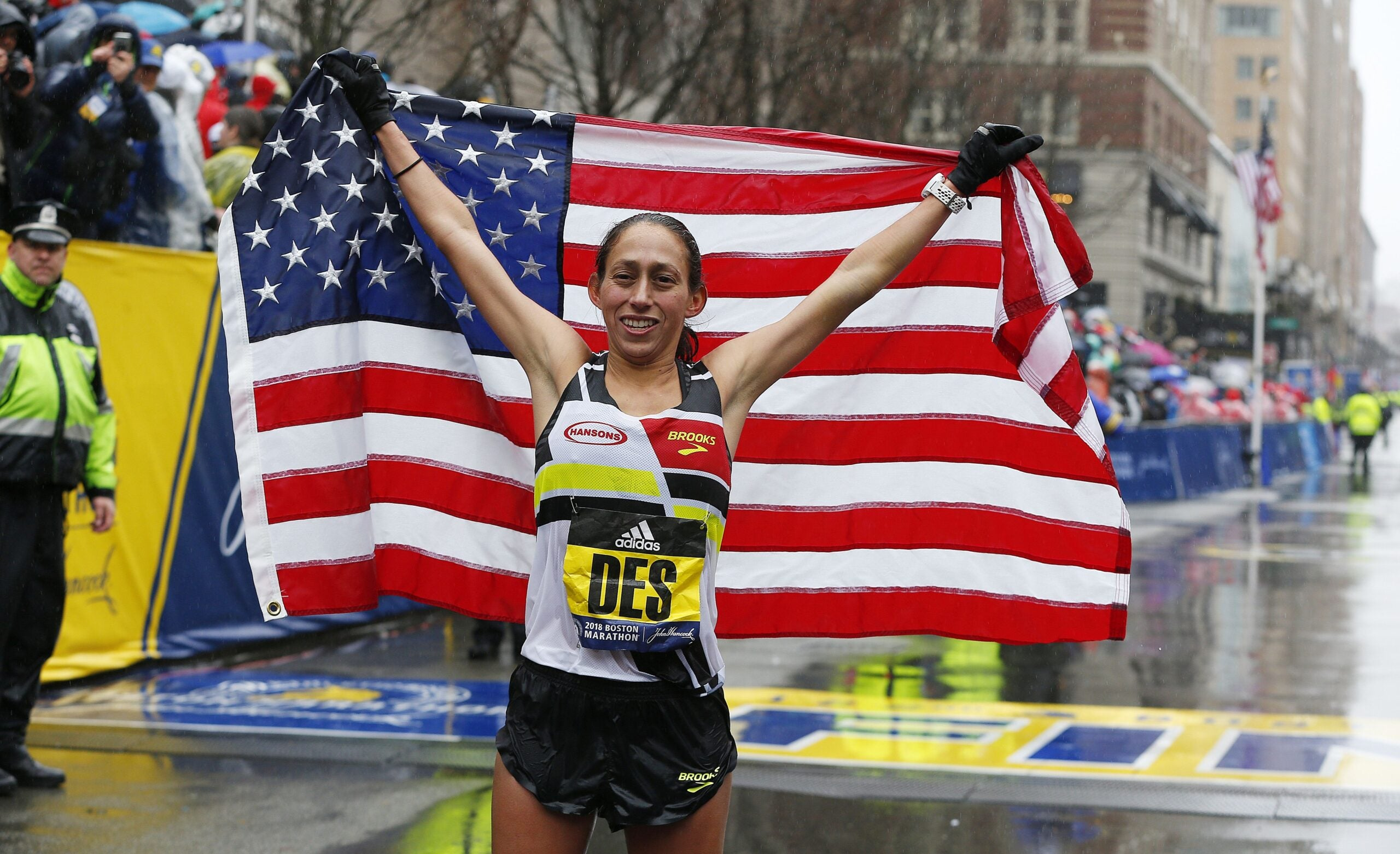 Desiree Linden of the US after crossing the finish line to win the women's division of the 122nd Boston Marathon.