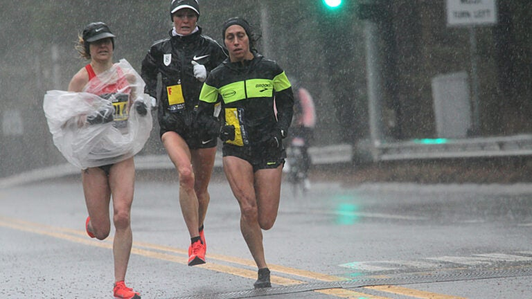 Wellesley, Ma., 04/16/18, The elite women runners make their way through a downpour in Wellesley. Wellesley College students braved the bad weather to cheer on the Boston Marathon runners.