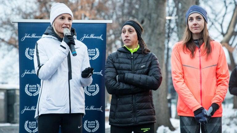 Shalane Flanagan, Desiree Linden and Molly Huddle speak before a training run for John Hancock employees on the Esplanade in Boston, 2017.