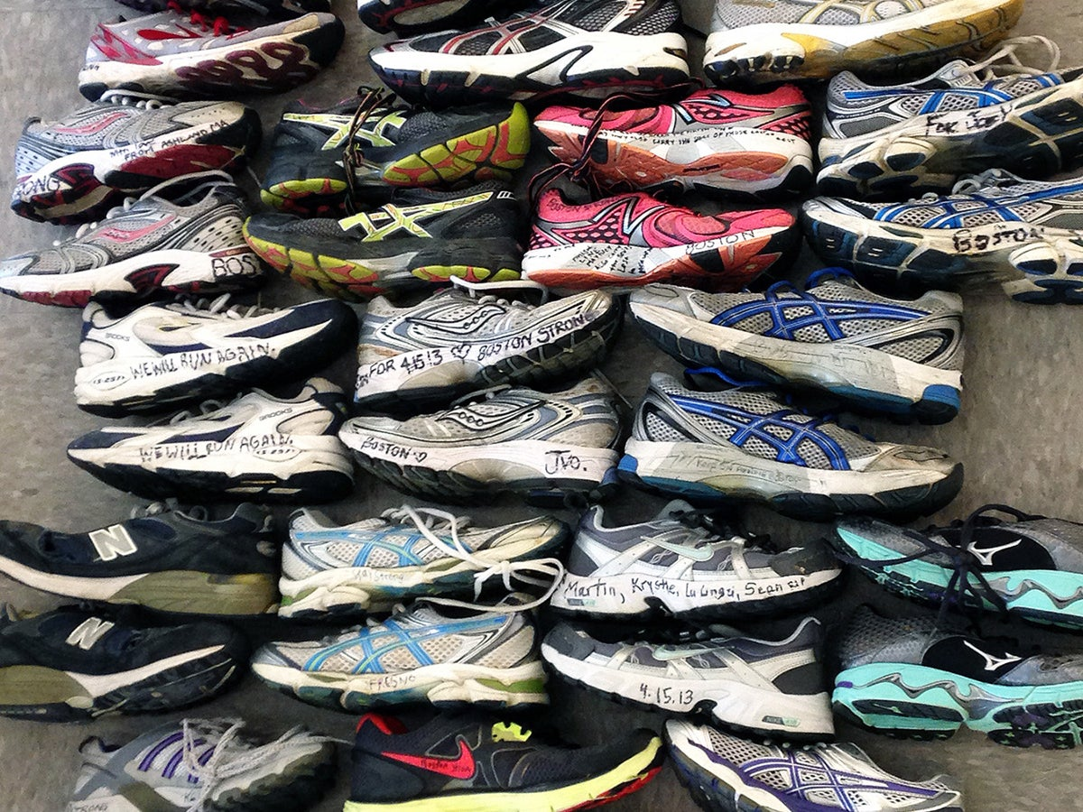 """The tower of sneakers featured in """"A Long-Distance Relationship: The 26.2 Mile Journey"""" at the Attleboro Arts Museum."""