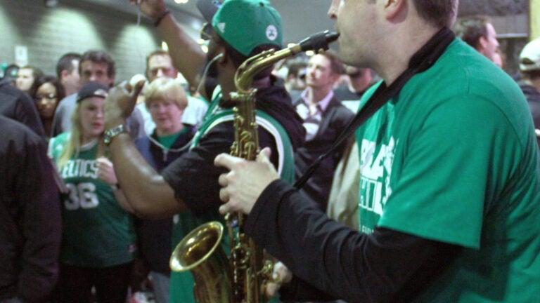 Saxophonist Joe Sparkes performs for a Celtics crowd outside TD Garden.