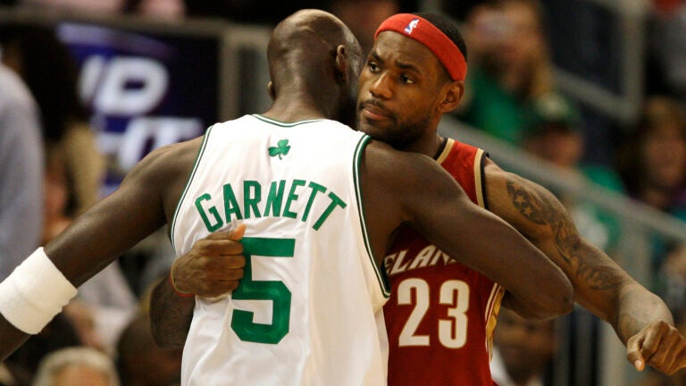 Boston Celtics forward Kevin Garnett, left, embraces Cleveland Cavaliers forward LeBron James prior to their preseason basketball game in Providence, R.I, Friday, Oct. 10, 2008. (AP Photo/Charles Krupa)