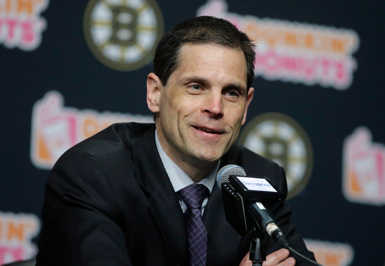 Boston Bruins general manager Don Sweeney takes questions from reporters during a news conference, Thursday, April 27, 2017, in Boston. The NHL hockey team are bringing head coach Bruce Cassidy back next season, dropping the interim tag from his title as a reward for leading the team back to the playoffs for the first time in three seasons. (AP Photo/Steven Senne)