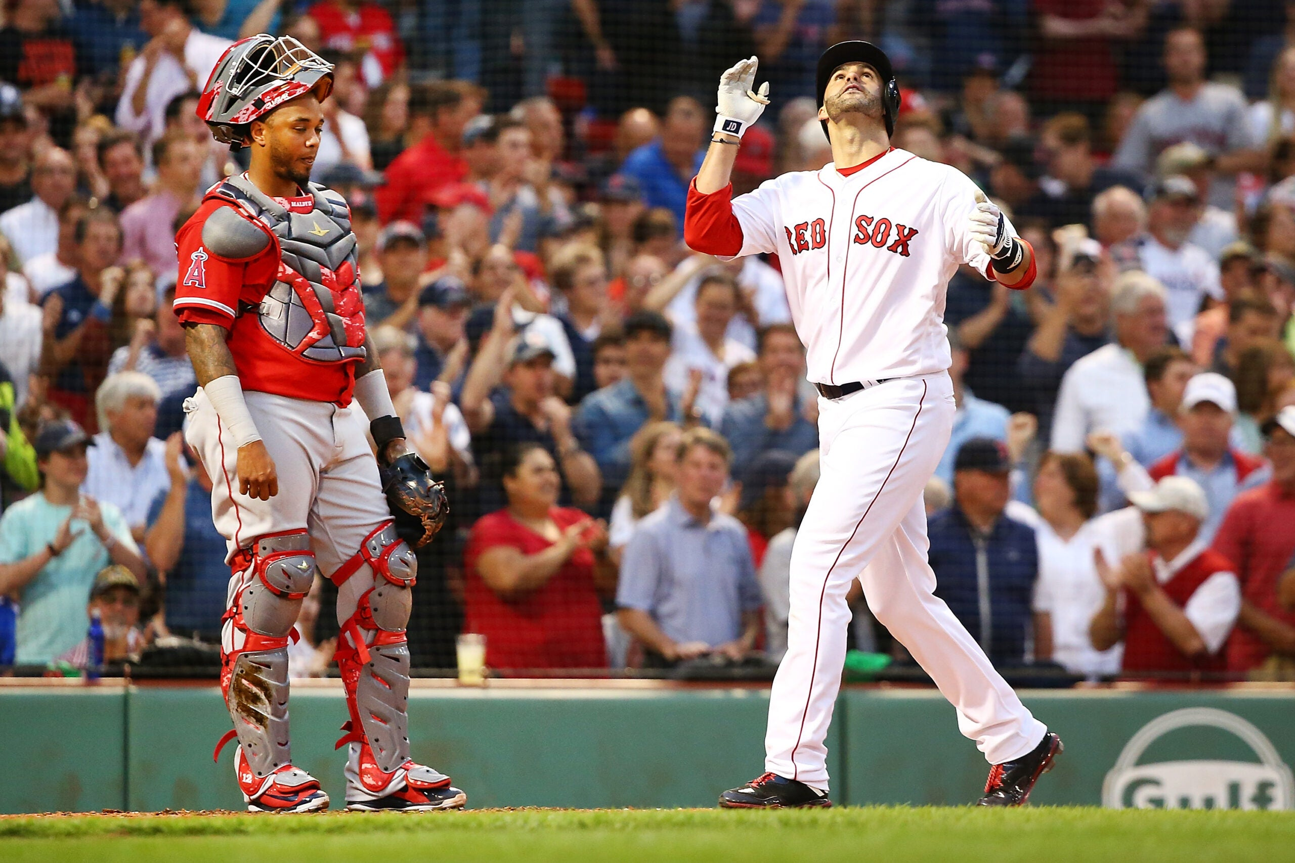 Red Sox hitter J.D. Martinez crosses home plate after hitting his 25th home run of the 2018 MLB season.