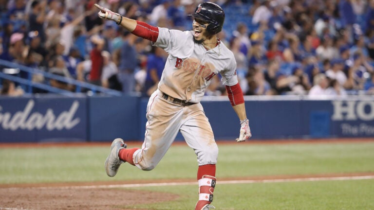 Mookie Betts celebrates his home run against the Blue Jays to complete the cycle.