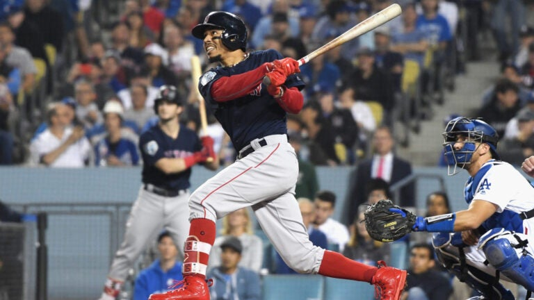 Mookie Betts hits a home run in Game 5 of the 2018 World Series.