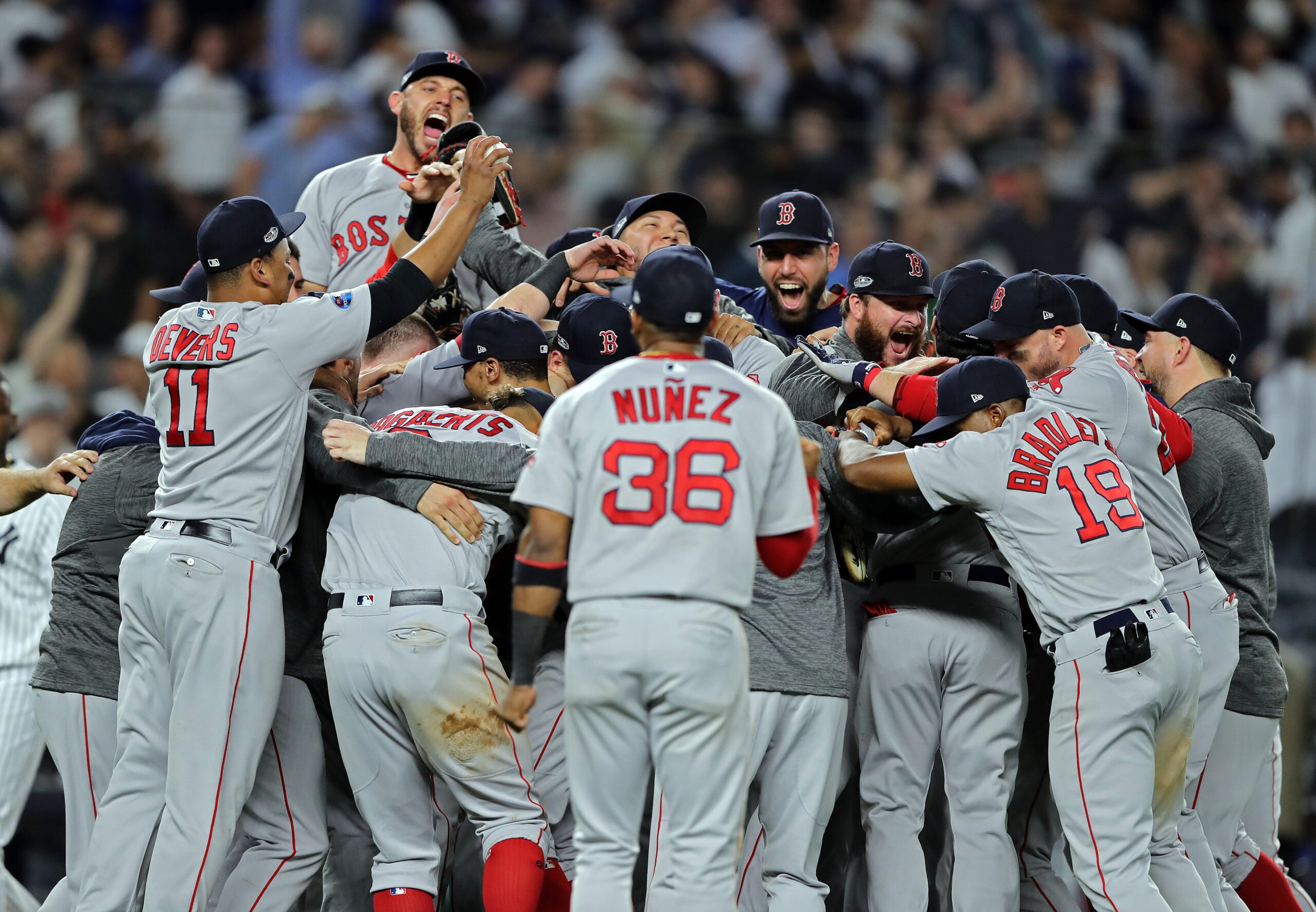The Red Sox celebrate in Yankee Stadium after advancing to the ALCS.