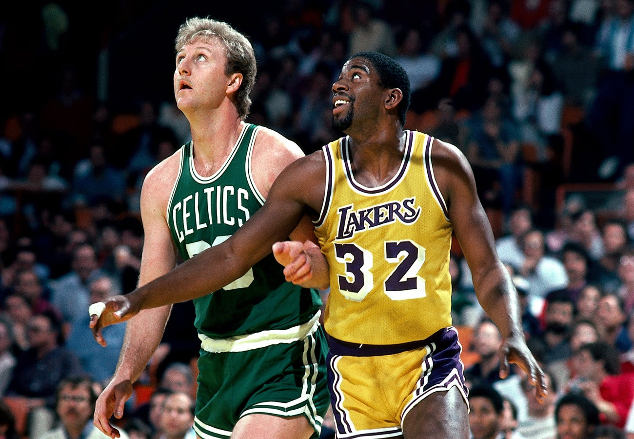 Larry Bird and Magic Johnson position for a rebound