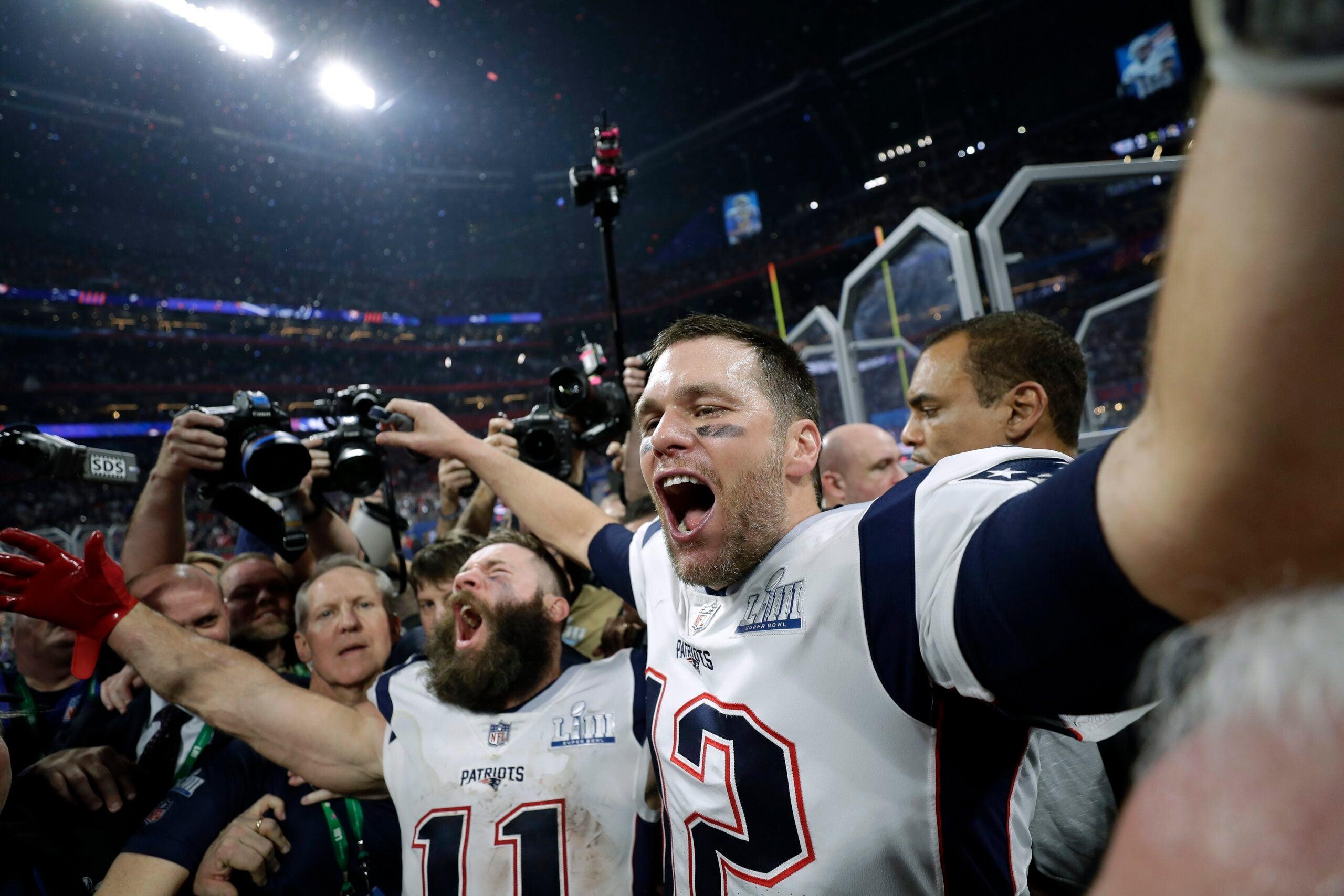 Julian Edelman and Tom Brady celebrate winning Super Bowl LIII.