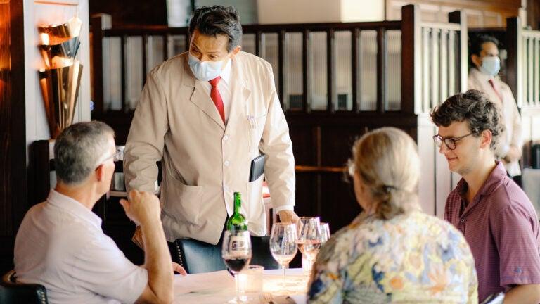 Waiter wearing mask