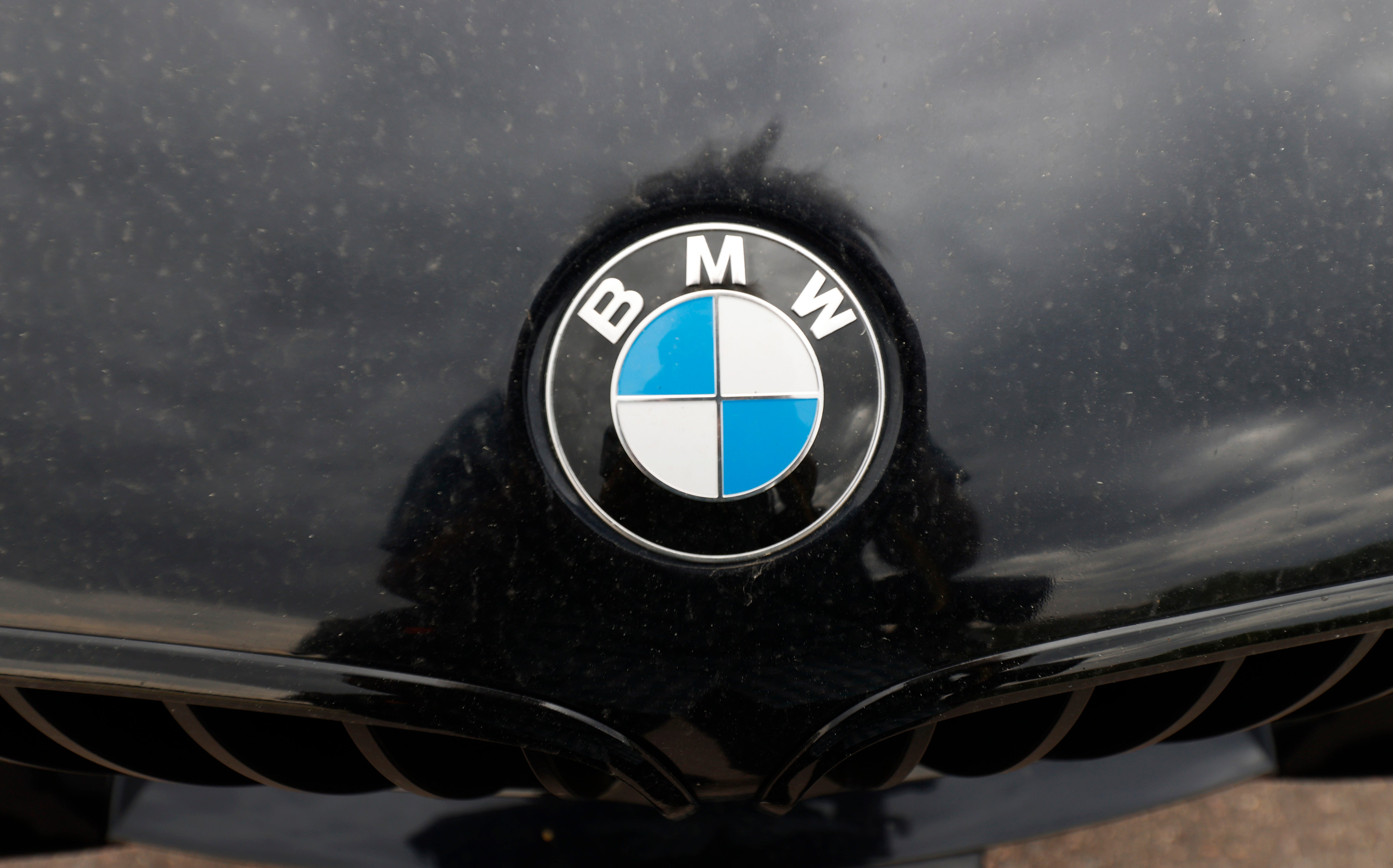 The company logo on the hood of an unsold 2020 5-series sedan