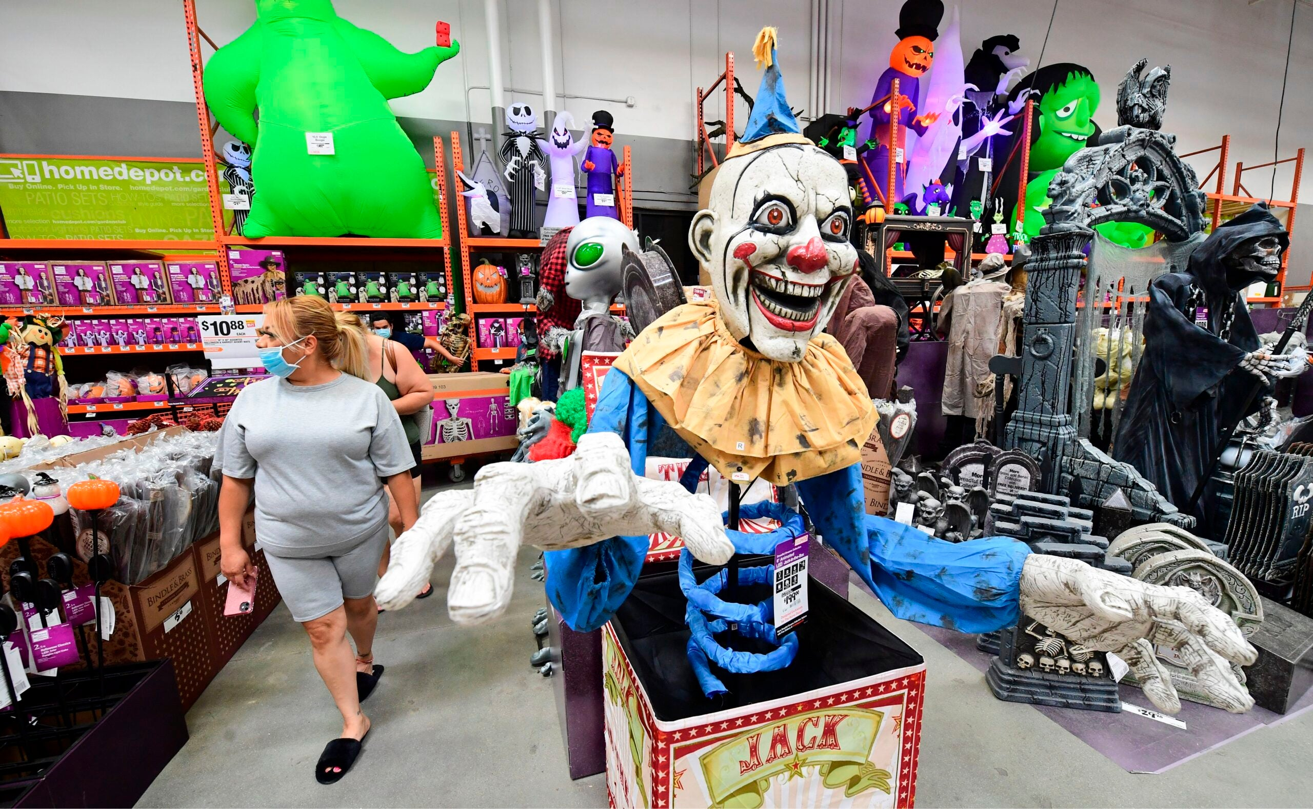 People shop for Halloween items at a home improvement retail store.