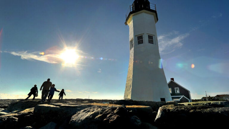 A brilliant afternoon sun lights up the Scituate Lighthouse.