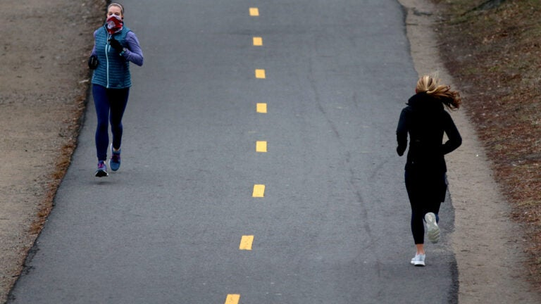 A pair of Joggers along the Charles River Esplanade.