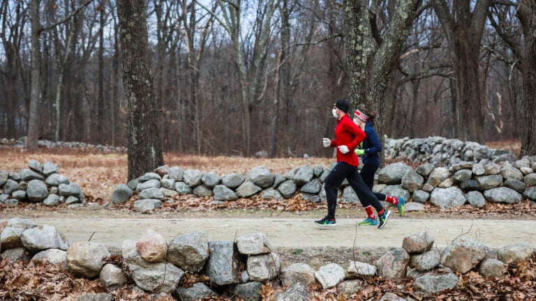 People enjoy the Minute Man trail in Concord.