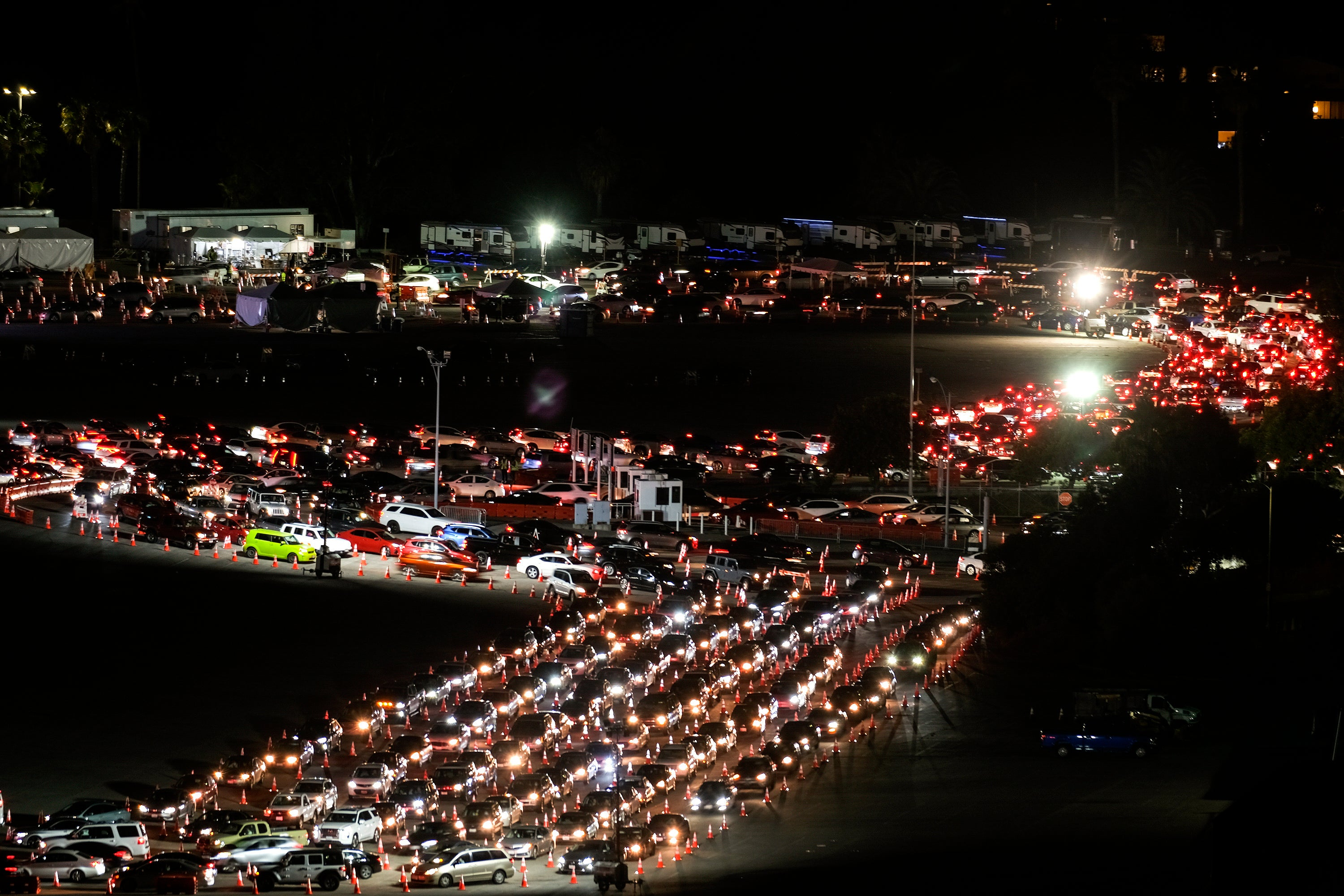 Motorists line up to take a coronavirus test in a parking lot at Dodger Stadium on Jan. 4.