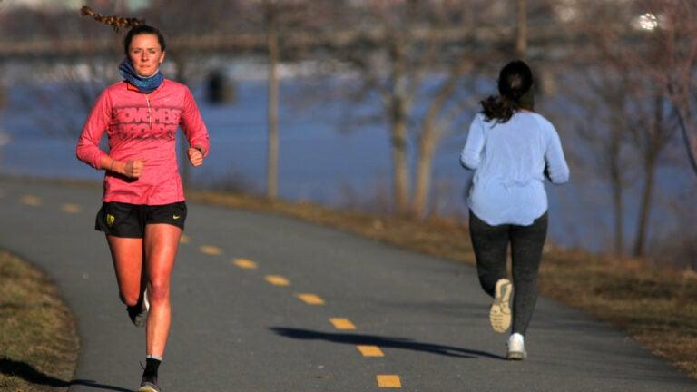 Runners along Memorial Drive in Cambridge.
