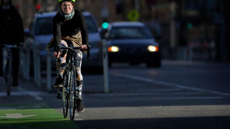 A cyclist pedals along Massachusetts Avenue in Cambridge.