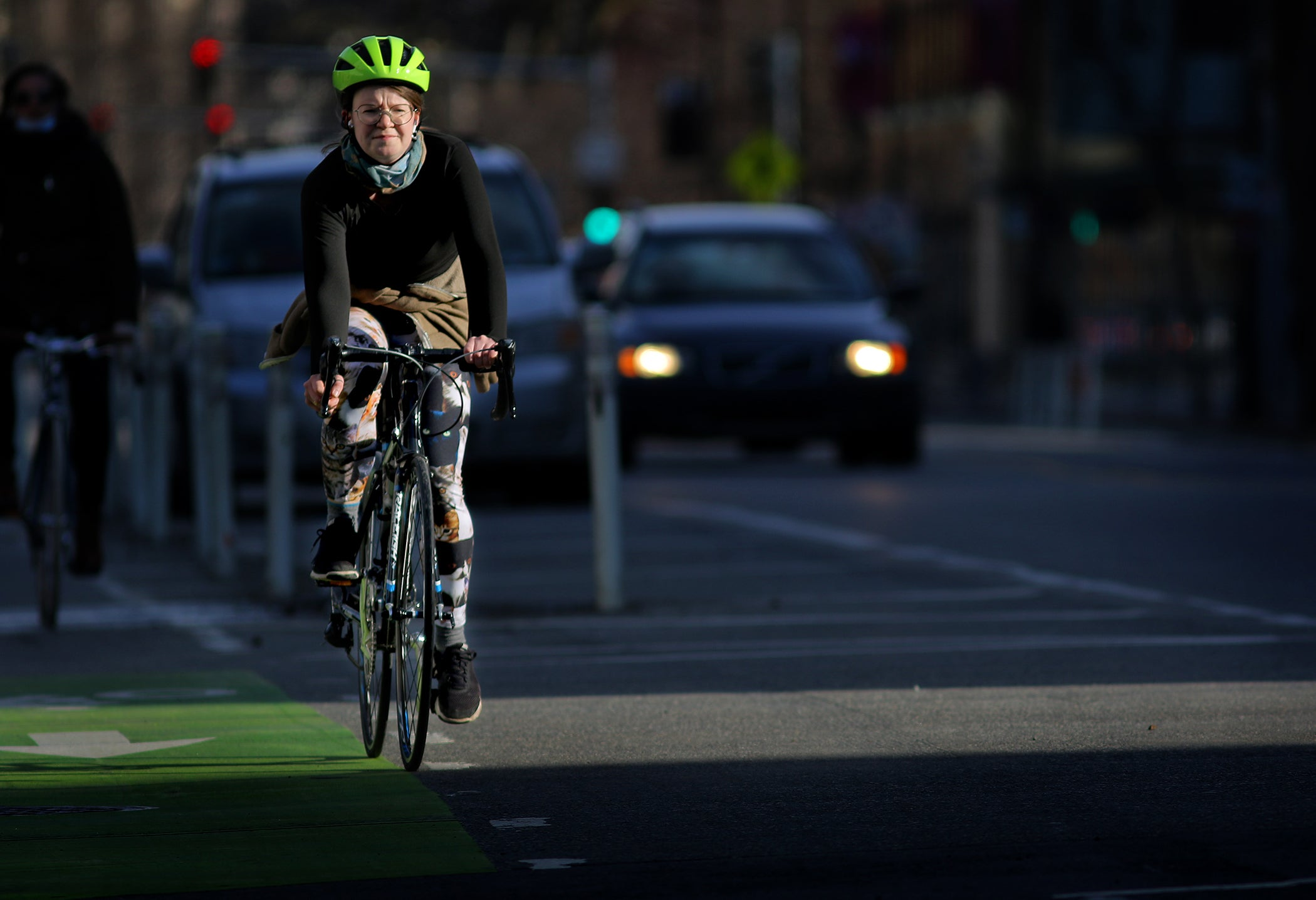 A cyclist pedals along Massachusetts Avenue in Cambridge.