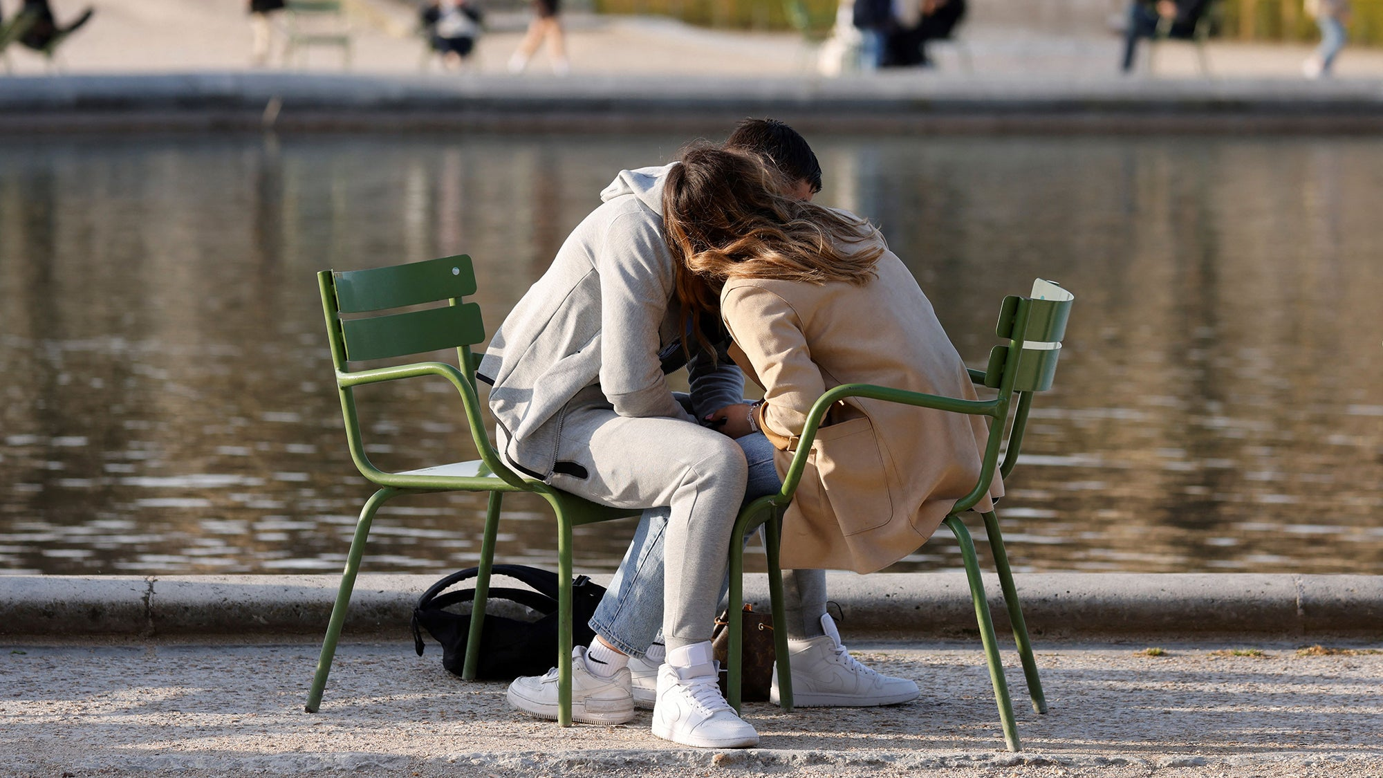 A couple kisses at the Tuileries gardens on March 24, 2021, in Paris