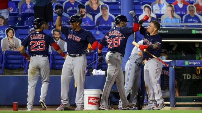 J.D. Martinez (28) celebrates his two-run home run with Michael Chavis, Rafael Devers, and Christian Vazquez.