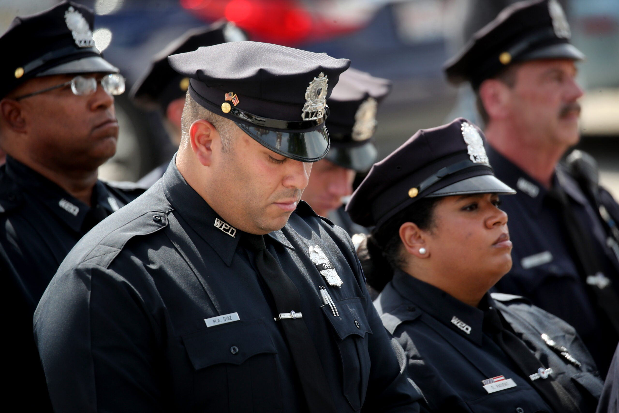 City honors officer who died trying to save drowning boy 10