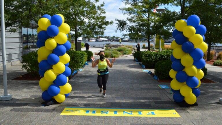 Marissa Gallo crossing the finish line