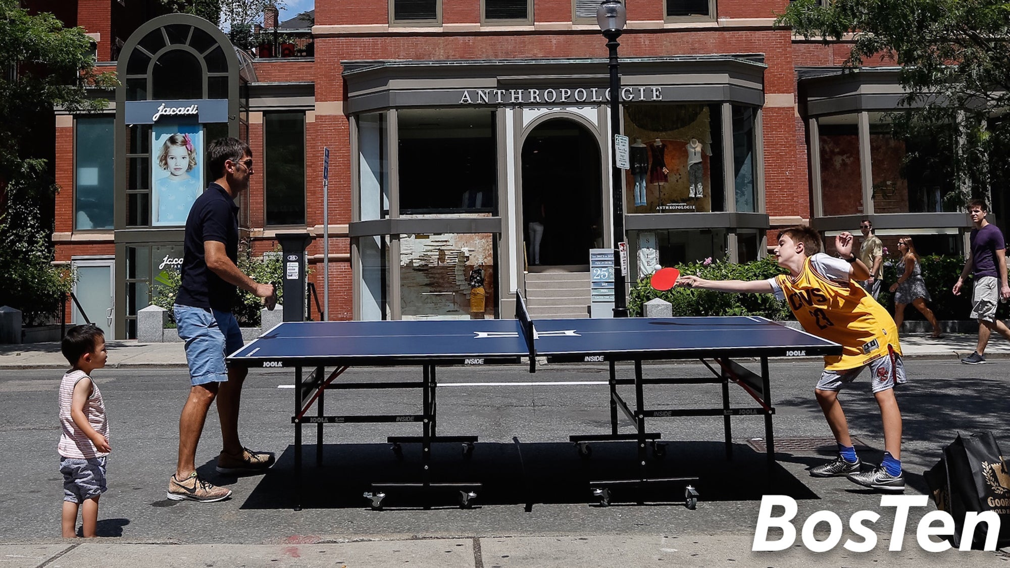 David Gilo and his son Nicholas Play ping pong in the middle of Newbury Street
