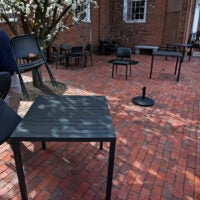 Ristorante Lucia restaurant's owner, Philip Frattaroli sets up tables in the courtyard